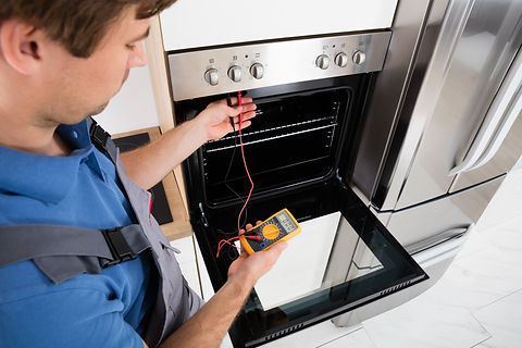 Oven being tested by appliance repairs man