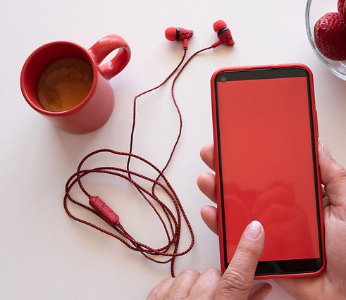 Red phone with red ear phones_edited.jpg