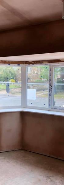 Plastering around bay window.jpg