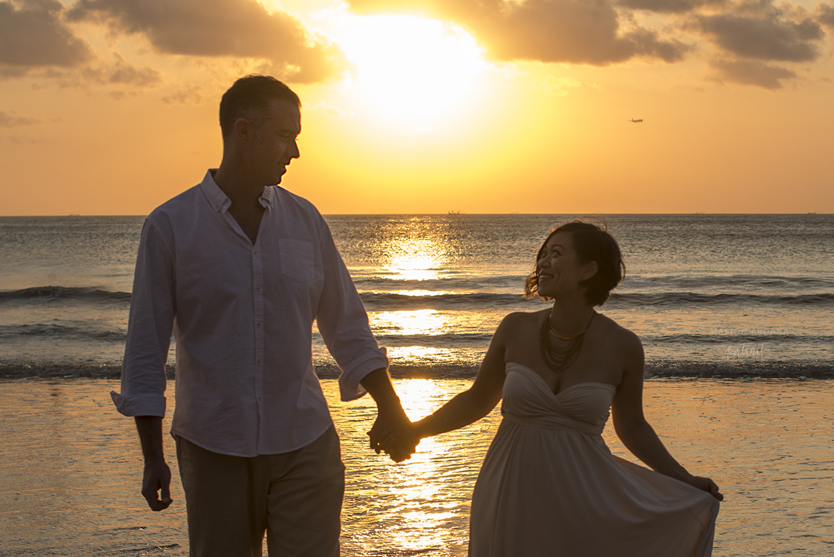A couple portrait in the sunset in Bali. A maternity couples photoshoot in Bali.