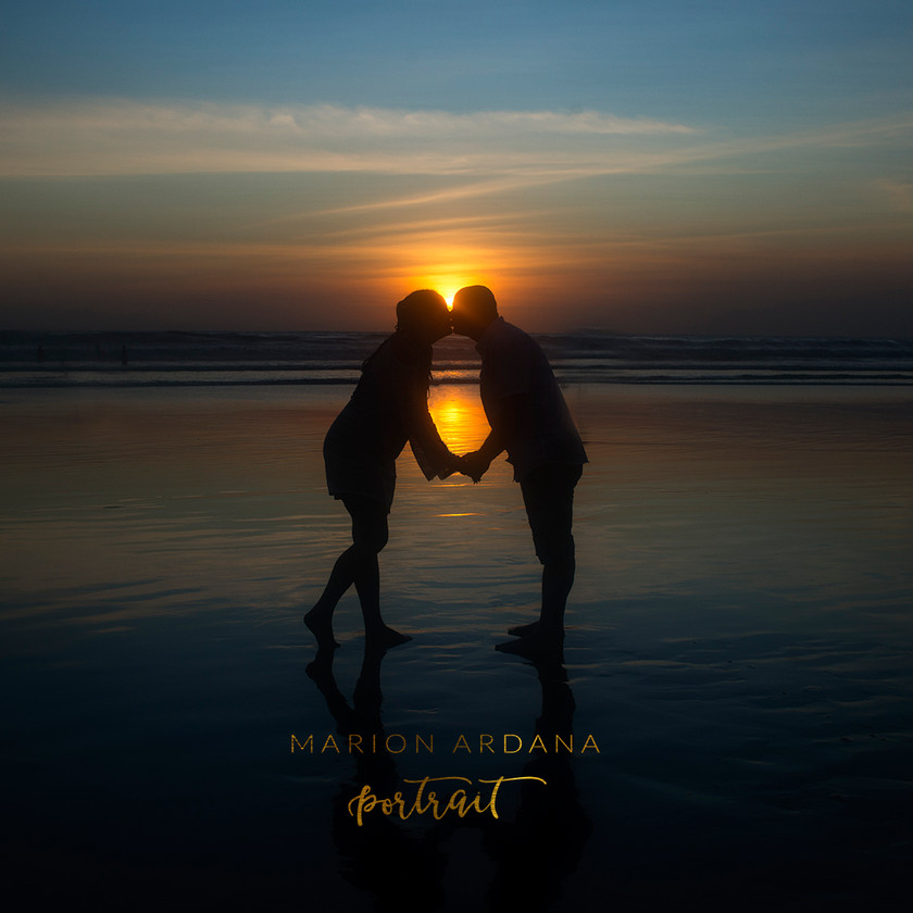 A sunset family photoshoot with this gorgeous couple on location in Bali with bali based photographer Marion Ardana Portrait