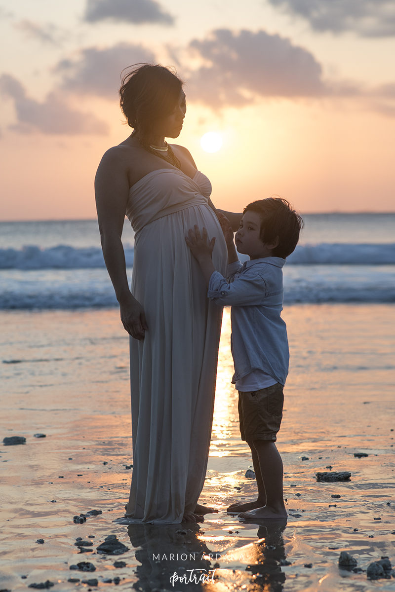 babymoon portrait of mother and son. A maternity portrait in the sunset in Bali.