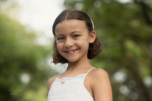 Capturing beautiful childrens portraits in Bali. here we have a portrait of a young girl on holidays in Bali captured by  a photographer in  Bali Marion Ardana photographer.