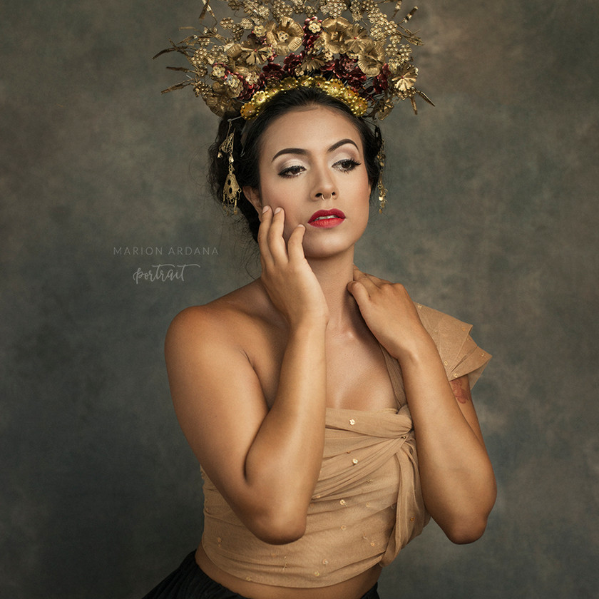 A fine art portrait from a creative photoshoot in Bali with lighting, makeup and props to enhance the themes. Editing in photoshop. With Bali  Based Photographer marion Ardana Portrait