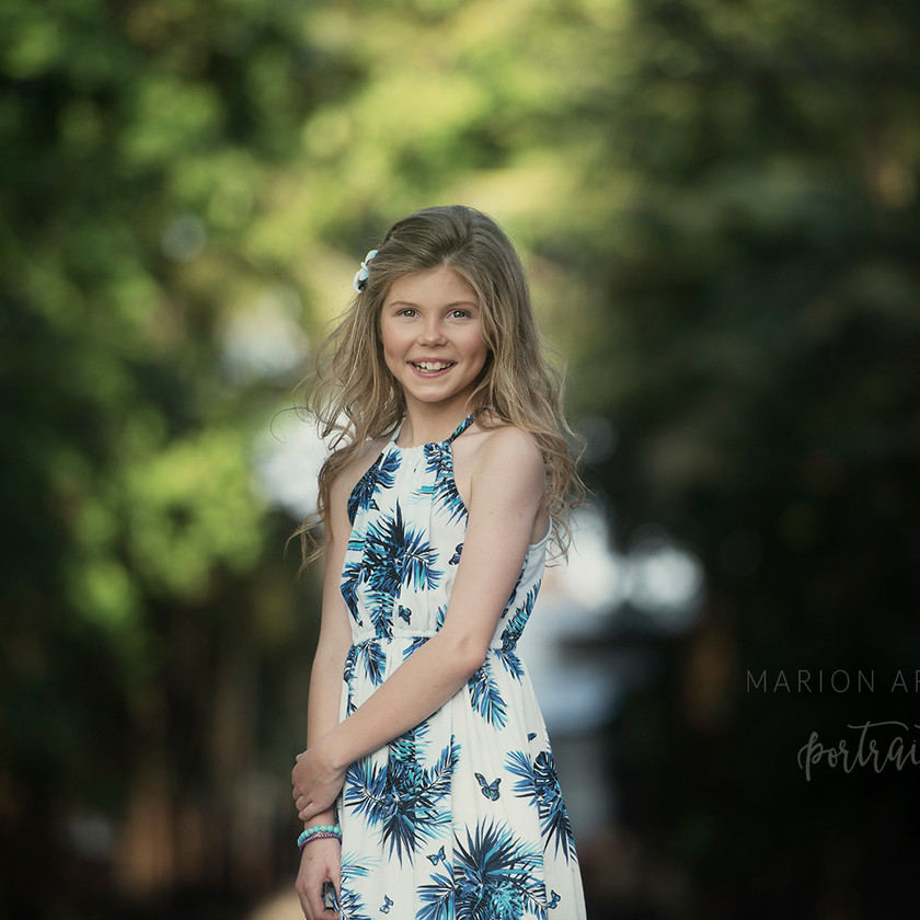 a beautiful portrait of a young girl taken during a family photoshoot in Bali with Bali based photographer Marion Ardana Portrait.