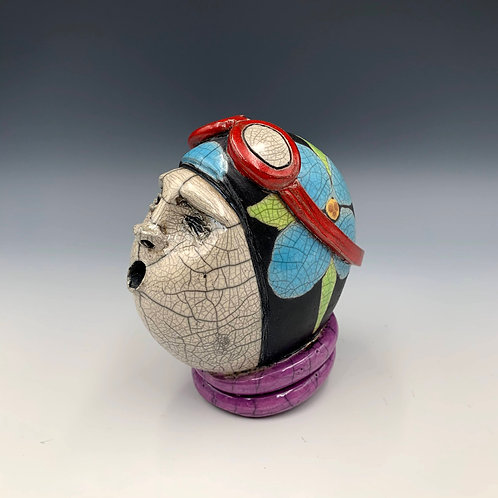"""The Swimmer"" is a whimsical, raku fired ceramic sculpture by JoAnne Bedient"