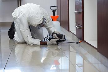 pest-control-man-spraying-pesticide-cabi
