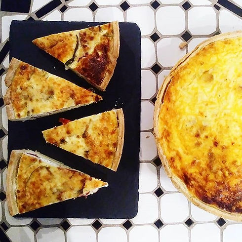 Homemade French quiche! Served by the sl