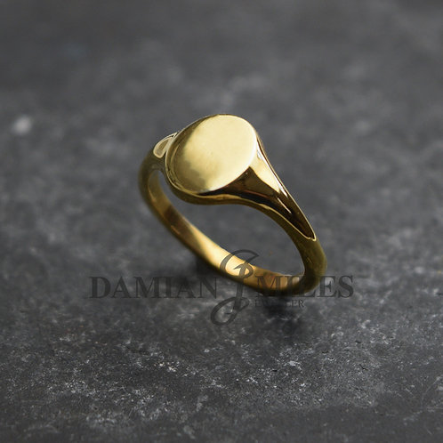 Lady's, small oval 9ct gold signet ring.