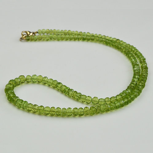 Peridot Beads on a 9ct gold clasp.