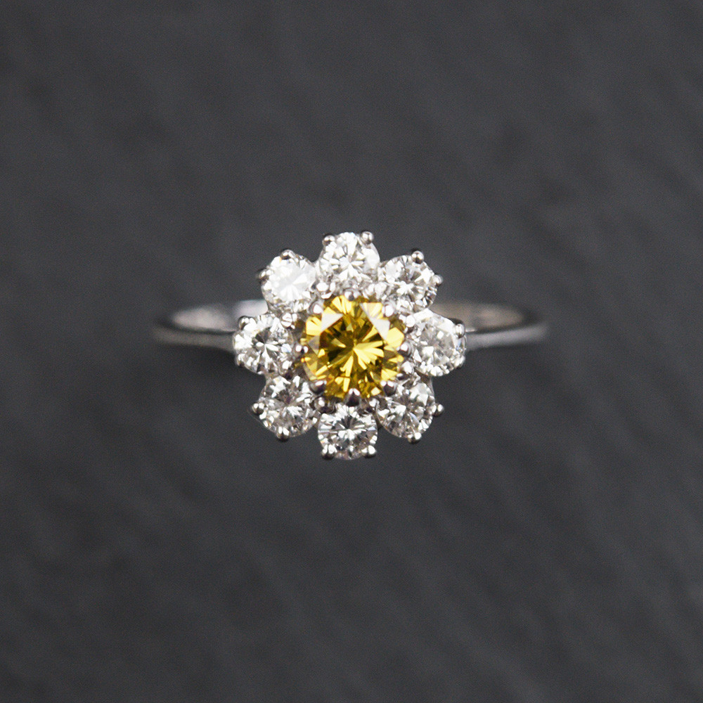 18ct white Gold Yellow and White Diamond ring.