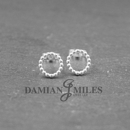Circular Beaded stud earrings in Sterling Silver.