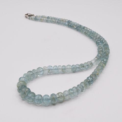 Aquamarine Beads on a 9ct white gold clasp.