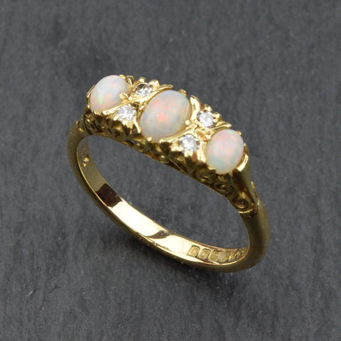 Opal and Diamond ring mounted in 18ct gold.