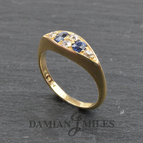 Antique, Boat shape, Sapphire and Diamond ring in 18ct gold.