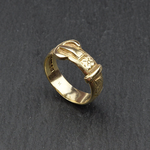 9ct gold Buckle ring with a hand engraved decoration.