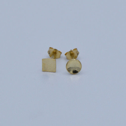 Mis matched stud earrings in 18ct gold