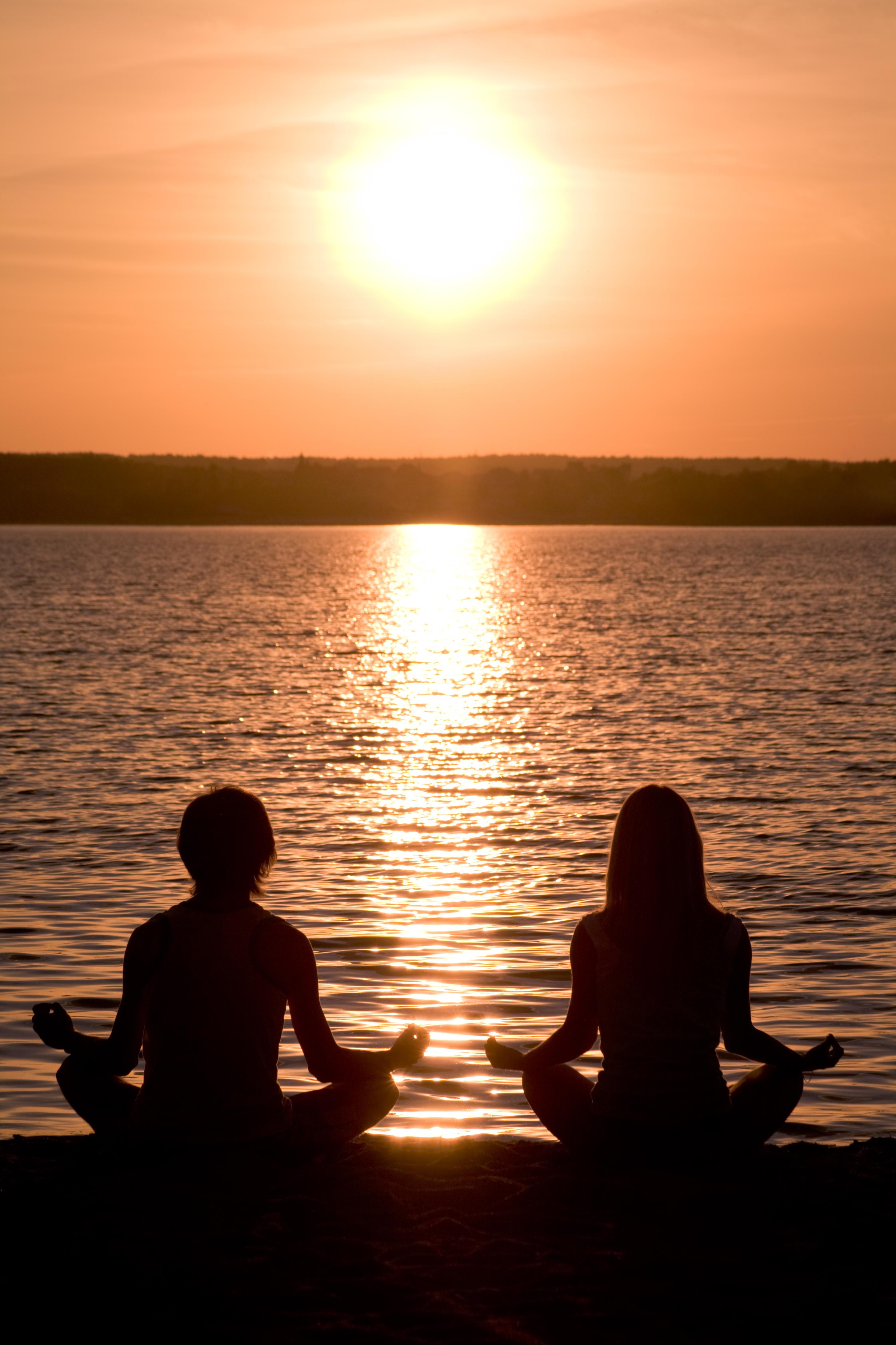 graphicstock-meditating-couple-sitting-i