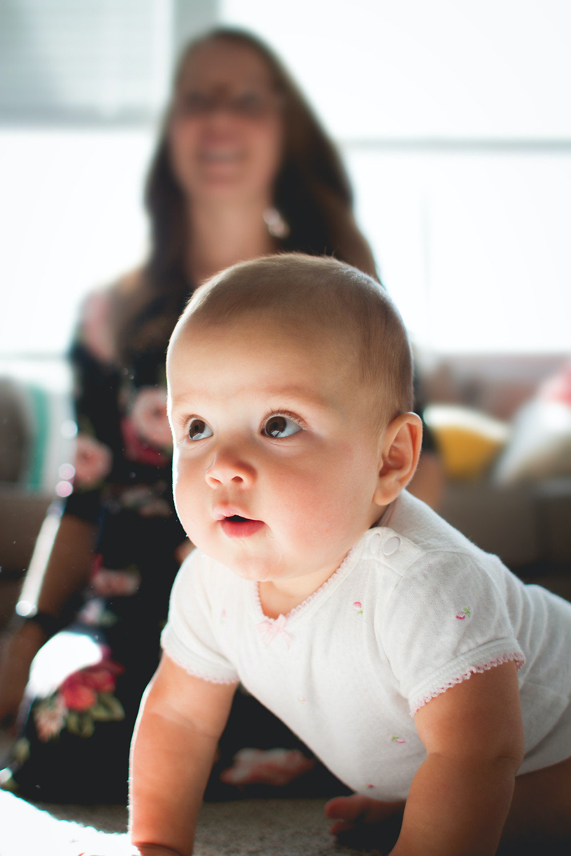 Baby playing with mum kevin-gent-mVk7pnnlULc-unsplash.jpg