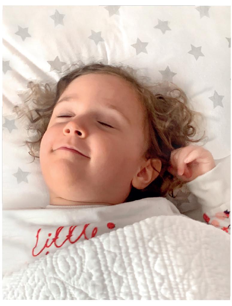 Little girl asleep with her Little Chick London Toddler Pillow