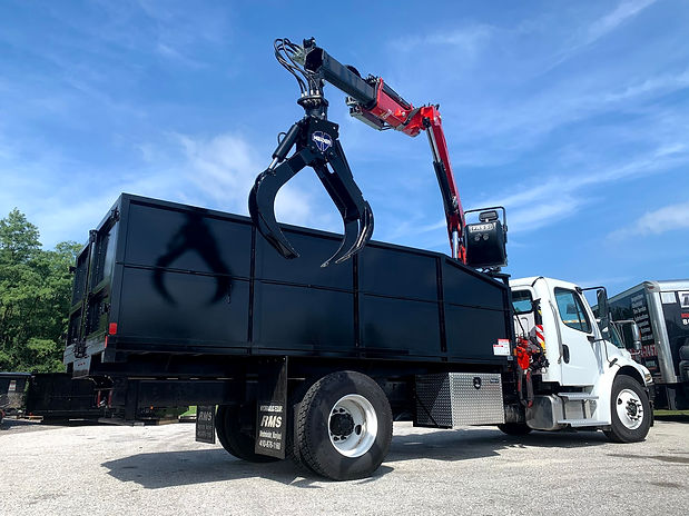 FASSI Grapple with Heiden Crane and 26' Steel Dump Body mounted on Freightliner M2 Chassis