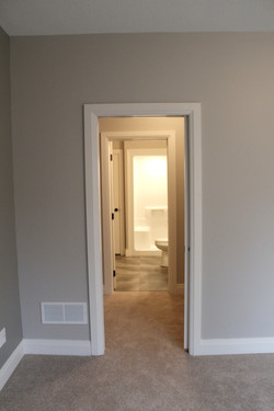 Master bedroom leading into walk in closet, walk through to ensuite