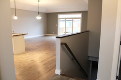 Stairs, open concept kitchen, dining room, living room