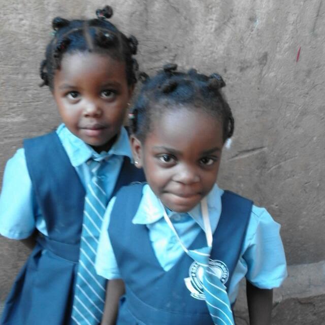 Kindergartners Mugisha and Chaniella
