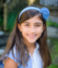 lulu in blue smiling like a school photo