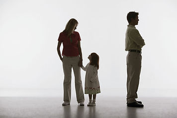 Image of a father turning his back on wife and child