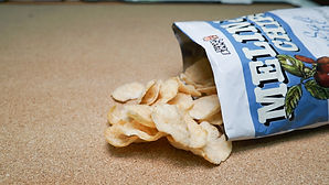 melinjo chips spilling out of bag.jpg