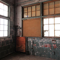interior of old warehouse with steel windows
