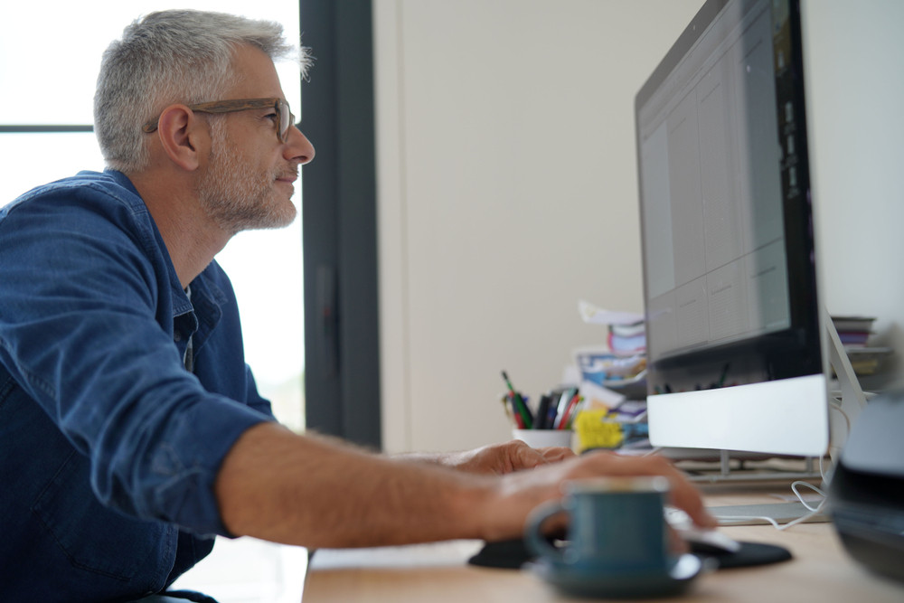 Man using a large computer monitor