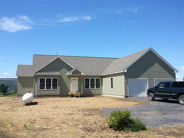 large modular home with attached garage vt