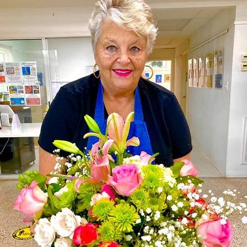 Barb Kuzin Artist with flowers 2021.jpg
