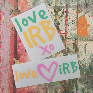 Love IRB Stickers on Art Table.png