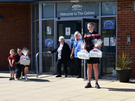 Hensingham ARLFC donate hampers to care home