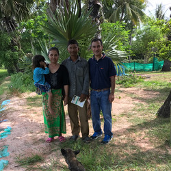 Dr. Khanal with farmer's family in Cambodia