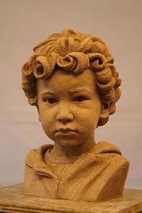 Clay portrait of child