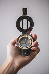 close-up-of-hand-holding-compass_4460x44