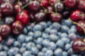 Fresh blueberries and cherries backgroun
