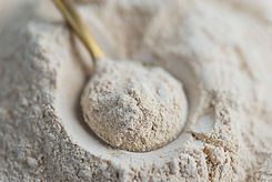 Lecithin powder in a spoon. Selective fo