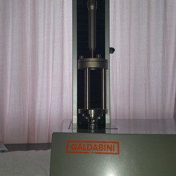 ASTM D4833 Fixture on a Material Testing System