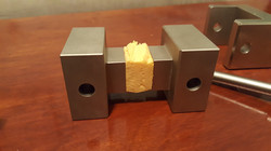 ASTM C297 with 1x1 inch blocks and sample