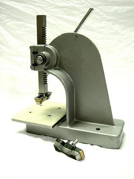 Arbor Press for cutting ASTM specimens