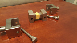 ASTM C297 fixture with bonded sample