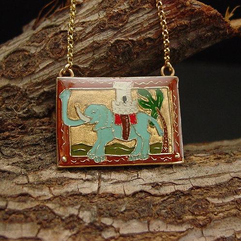 Elephant necklace on branch