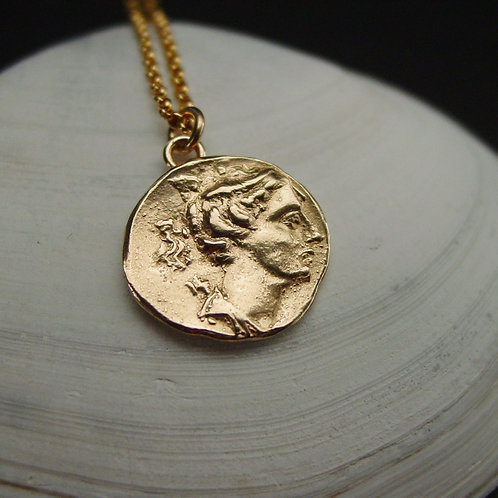 Artemis coin necklace on shell