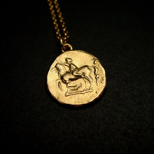 Youth on horse coin necklace close up