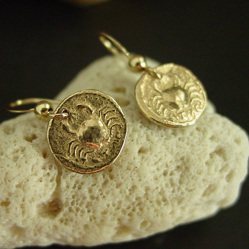 Crab coin earrings on coral
